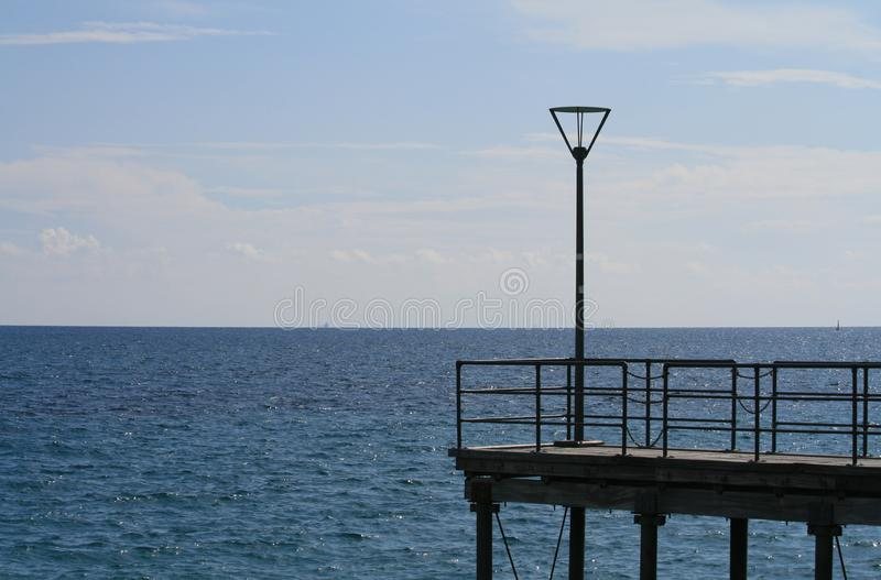 Street lamp on a sea pier stock photography