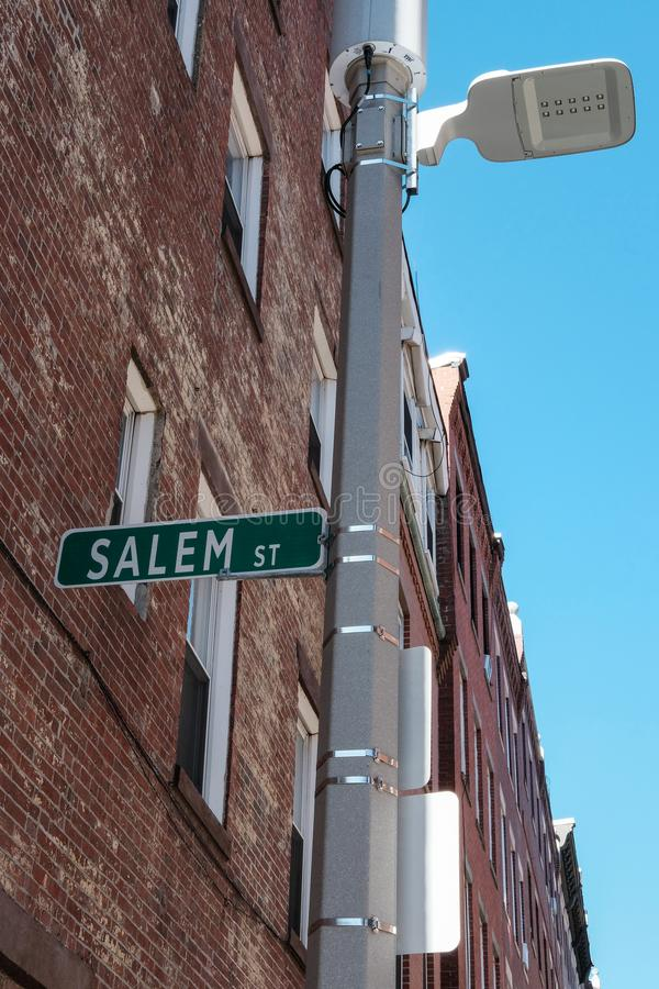 Salem Street sign seen in downtown Boston, MA, USA. This metal street sign can be seen attached to a new generation, low energy street light in a residencial stock photos