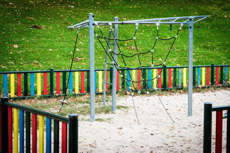 Metal structure with chains for climbing in playground royalty free stock images