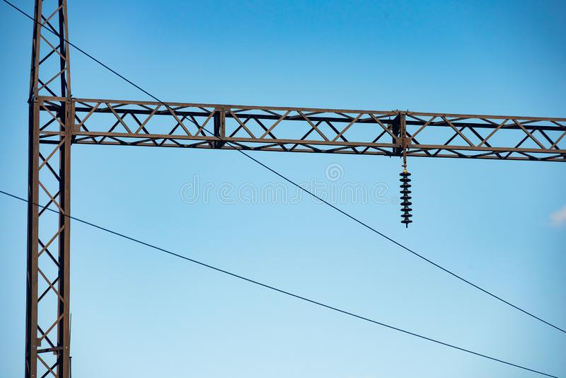 Metal structure high voltage transmission tower against a blue sky royalty free stock photography