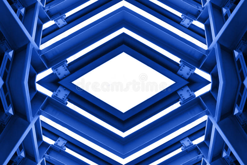 Metal structure similar to spaceship interior in blue tone.  royalty free stock photo
