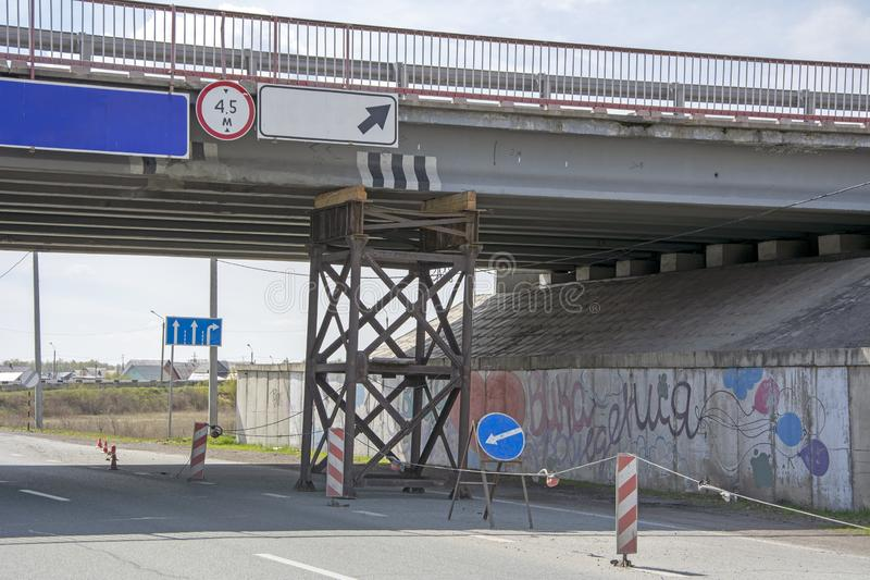 The metal support supporting the collapsing automobile bridge. Russia royalty free stock image