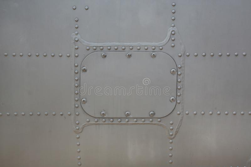 Metal surface background of military aircraft with cover.  stock images