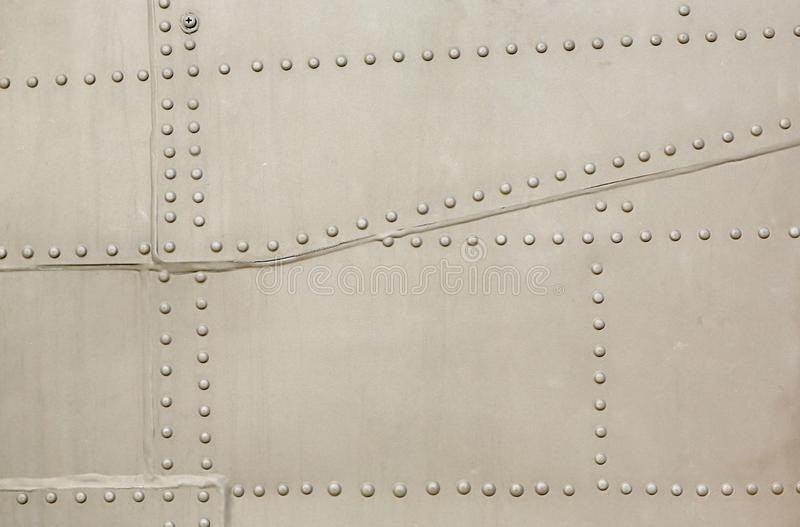 Metal surface of military aircraft.  stock images