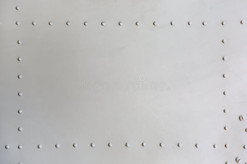 Metal surface of military aircraft.  stock photos