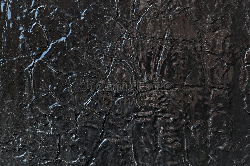 The metal surface is painted with black oil paint. stock photos