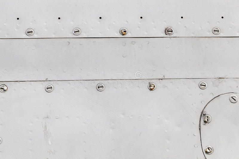 Metal surface with rivets royalty free stock images