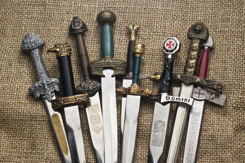 Metal swords. Various swords with different handles stock photography