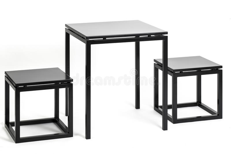 Metal table with two chairs. Metal square table with two chairs royalty free stock image