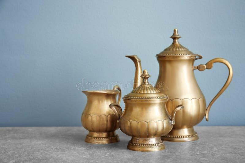 Metal tea set on table stock photos