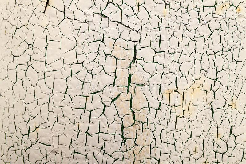 Metal texture with scratches and cracks. Cracking and peeling pa royalty free stock image
