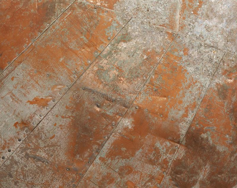 Metal texture from the wing of an airplane crashing at the beginning of the twentieth century.  royalty free stock photos