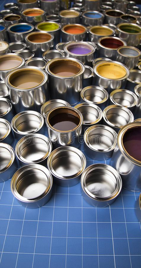 Metal tin cans with color paint stock photos