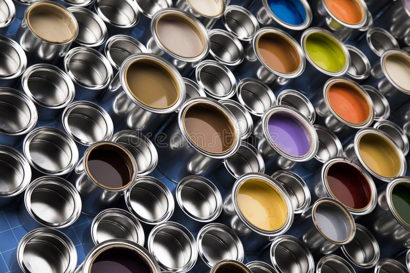 Metal tin cans with color paint stock photography