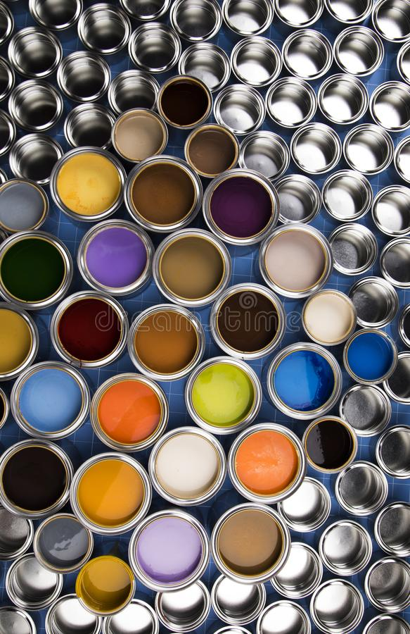 Metal tin cans with color paint royalty free stock photo