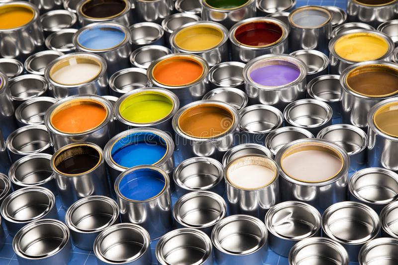 Metal tin cans with color paint stock photo