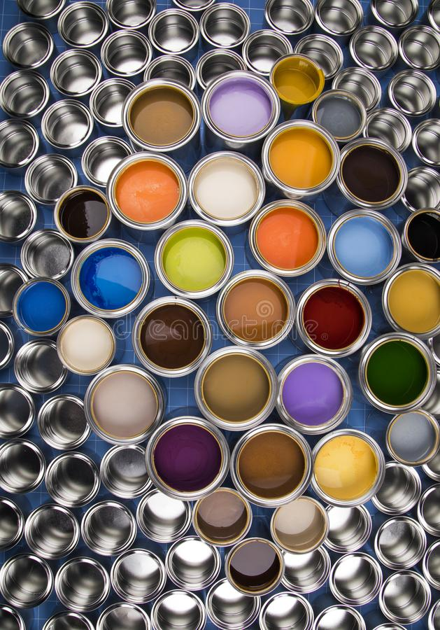 Metal tin cans with color paint stock images