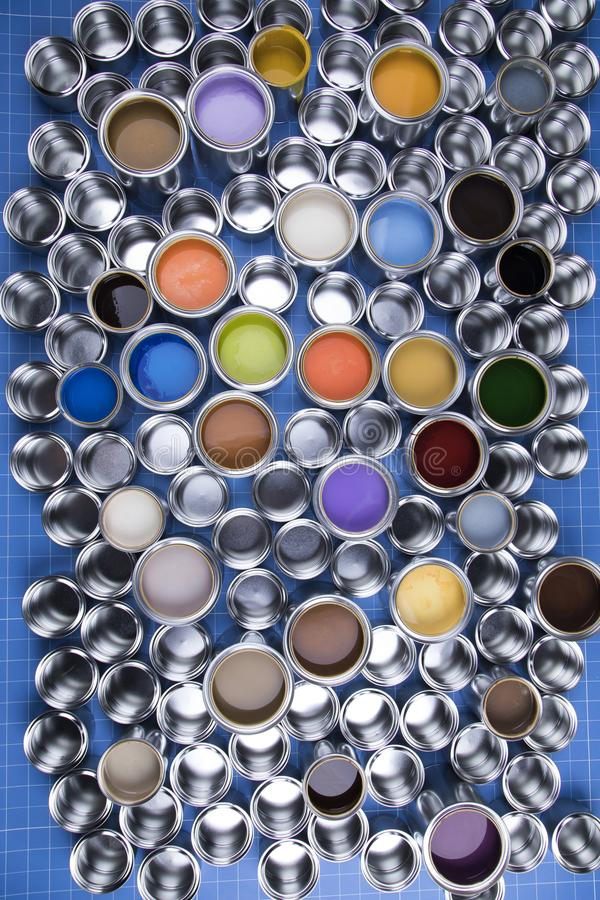 Metal tin cans with color paint royalty free stock photography