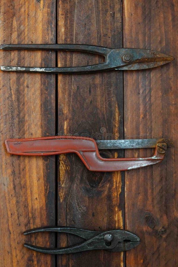 Metal tool. S for plumbing repairs, metal saws, pliers, metal shears, retro tools royalty free stock photo