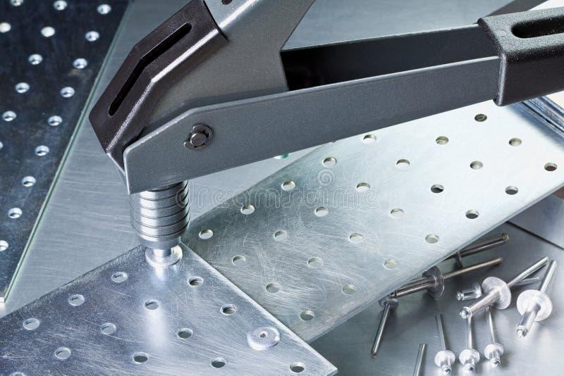Metal tools. Metal workshop. Rivet gun, applicator and rivets royalty free stock photo
