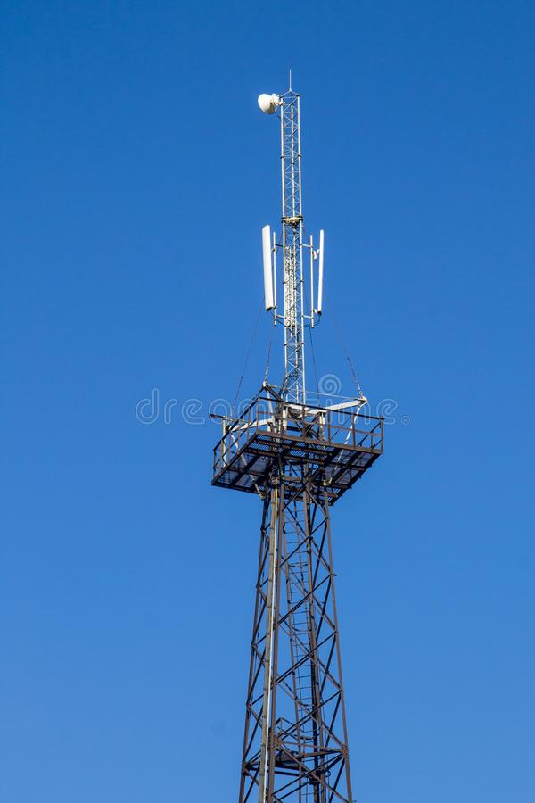 Metal tower with antennas for mobile cell phone communications royalty free stock photos