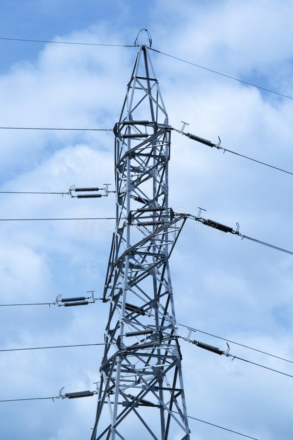 High voltage tower. Metal tower that supports thick electric current conductors royalty free stock photo