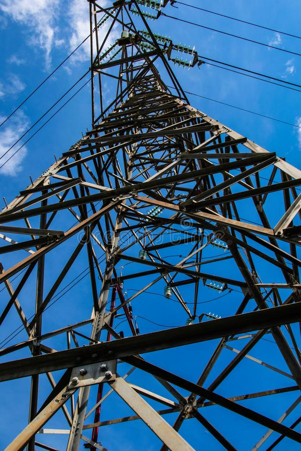 High voltage tower. Metal tower that supports thick electric current conductors stock photos