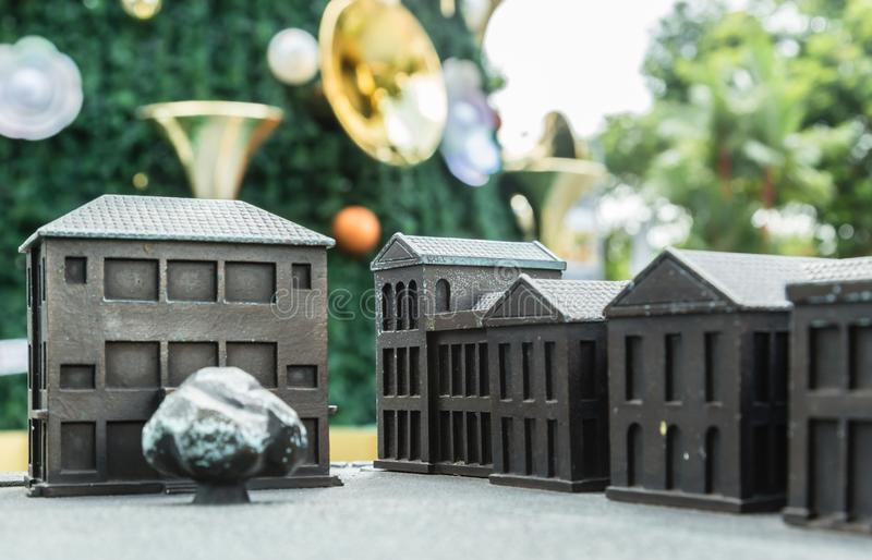 Metal toy house with green Christmas tree view royalty free stock images