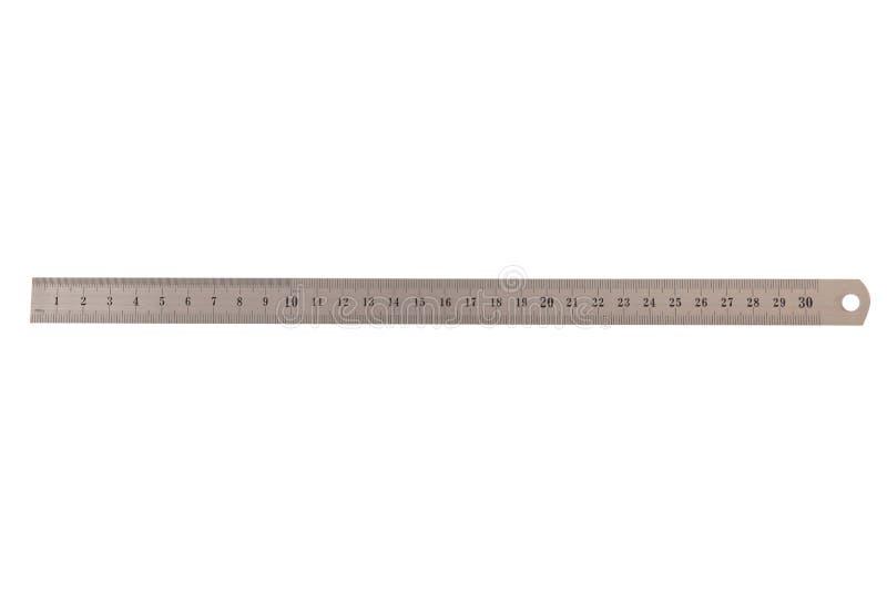 Metal trzydzieÅ›ci centymetrów wÅ'adcy odizolowywajÄ…cej na bielu zdjęcia stock