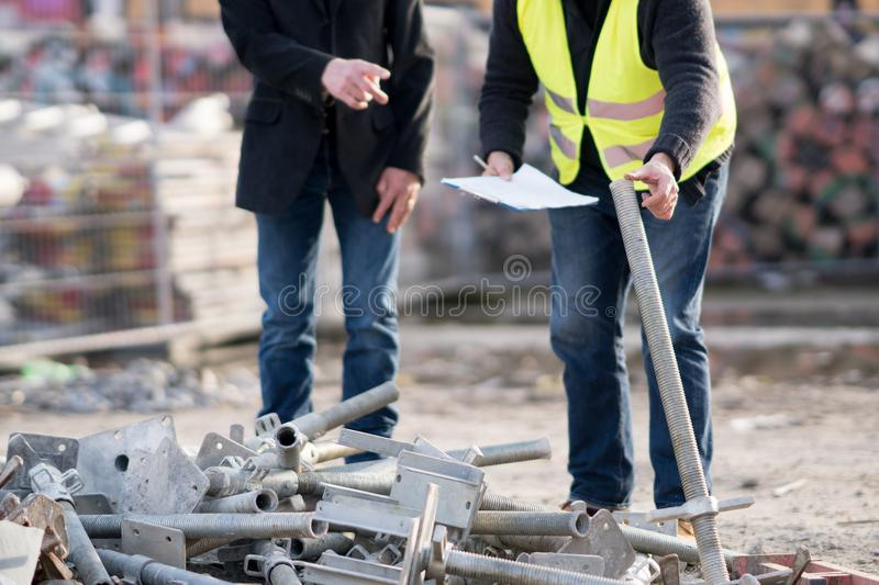 Metal tubes on construction site royalty free stock images