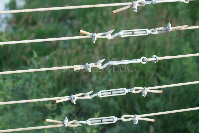 Metal turnbuckles fastening of hawser with steel rod stock photos