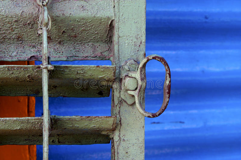 Metal venetian blind and a blue in la boca buenos aires. Argentina royalty free stock images
