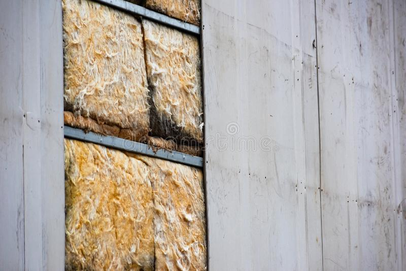 Metal wall with glass wool inside. Is close, thermal, insulation, house, construction, building, protection, home, material, energy, insulate, heat, improvement royalty free stock photography