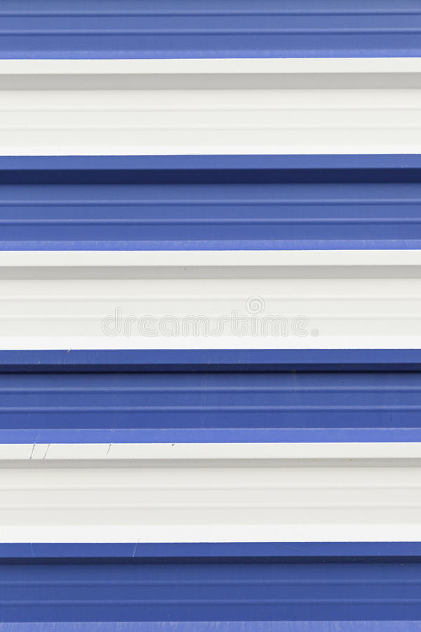 Metal wall painted white and blue stock images
