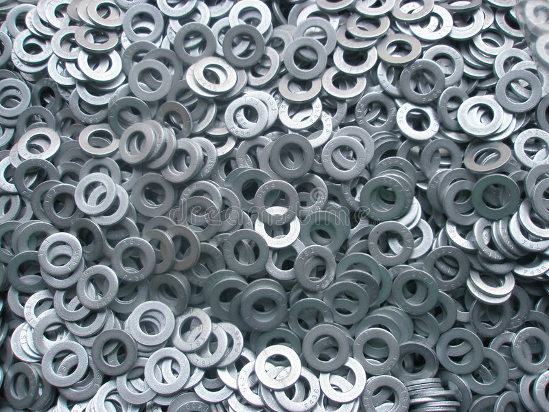 Metal Washers 2. Thousands of metal washers in pile for background stock photography
