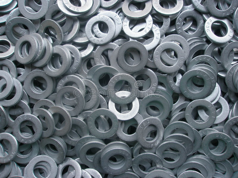 Metal Washers. Isolated Pile of metal washers stock image