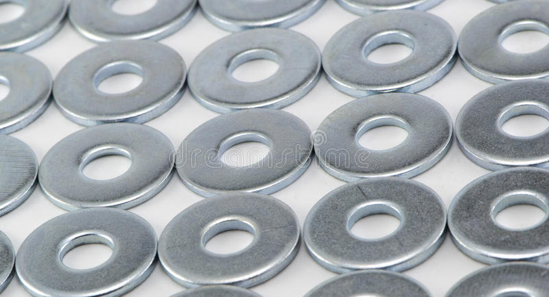 Metal washers. The metal washers on a white background royalty free stock photos