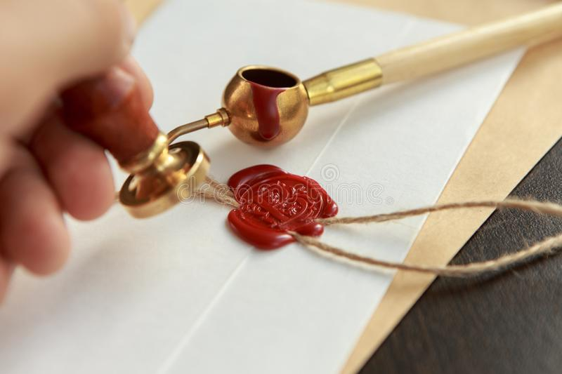 Metal wax notary public stamper on old document. Law office royalty free stock image