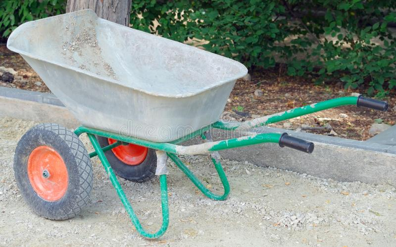Metal wheelbarrow cart royalty free stock photos
