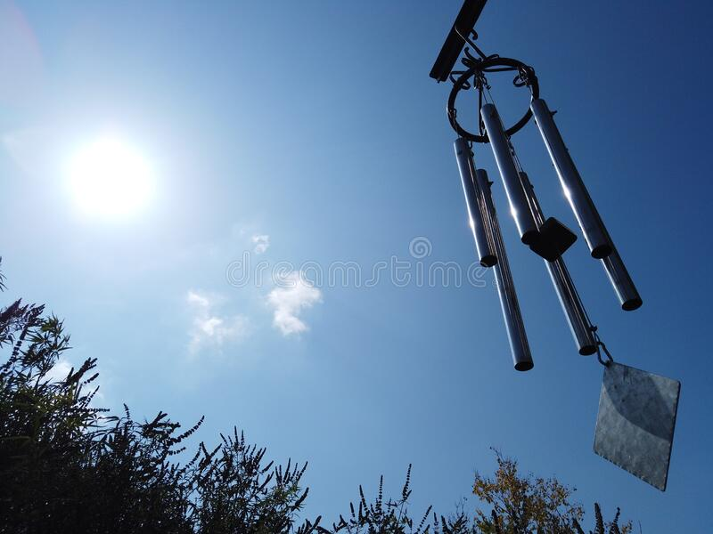 Metal Wind bells hanged on a balcony for relaxation and zen royalty free stock image