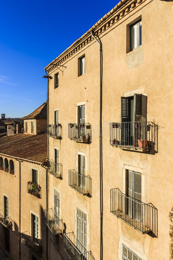 Window balconies with potted plants at Cathedral Square, Girona. Metal window balconies with potted plants at Cathedral Square, Girona royalty free stock image