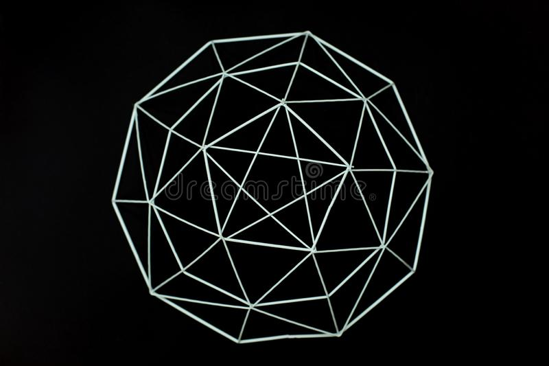 Metal wire decorative geometric elements, basket, vase on a black background. MInimal concept. Beautiful abstract pattern of metal stock photography