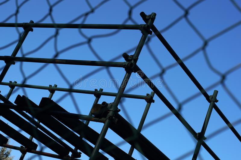 Metal wire fence protection. At the construction site with a blue sky background stock images