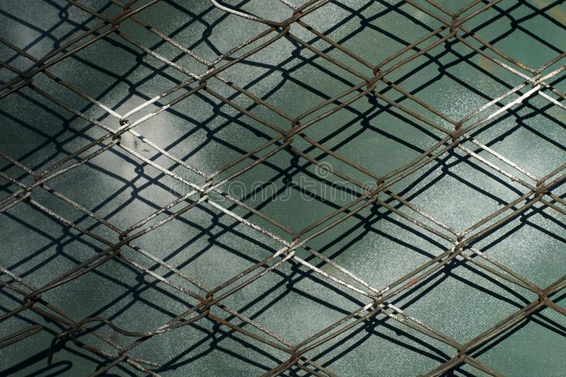 Metal wire fence protection. From a dark background stock photos