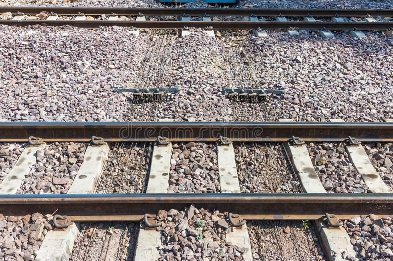 Metal wire pulley system under the railway track. stock images