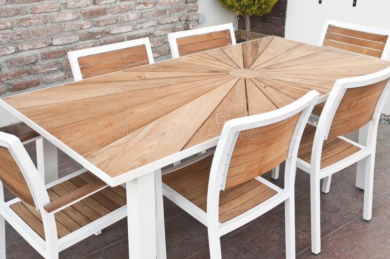 Metal and wood outdoor patio furniture for dining royalty free stock image