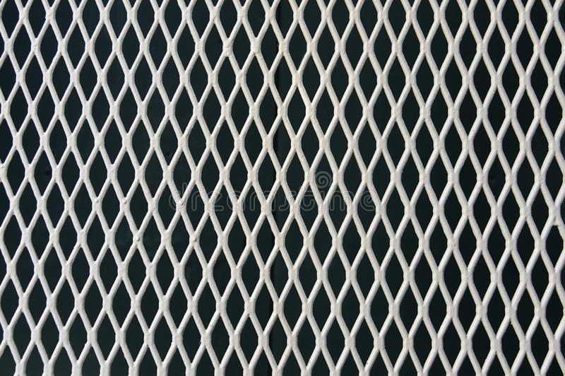 Metal wrought iron grating background. Texture close up royalty free stock photo
