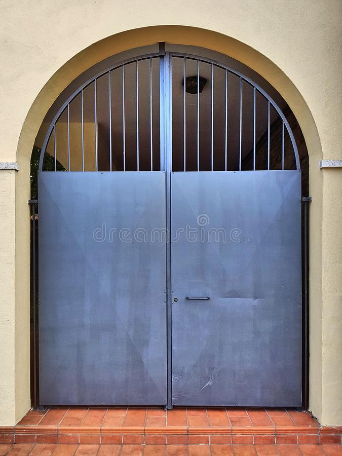 Metal yard door with arch and grating. royalty free stock photo