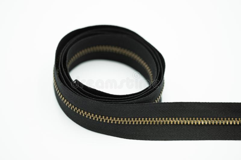 A metal zipper in brown color royalty free stock photography