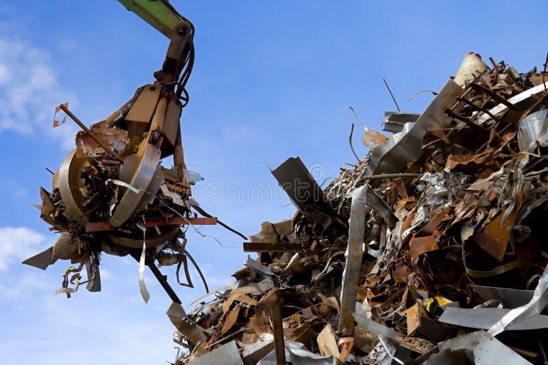 metall för avskrädegrabberpäfyllning arkivfoto